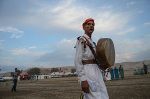 A Bendir musician and performer, part of the fantasia's traditional entertainment, watches on. Tissa, Morocco