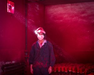 Worker at a Christmas decoration factory, China. Contemporary Issues Singles, 2nd place. Ronghui Chen, China, City Express.