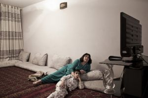 "Mother and kid watch ""Valley of Wolves"", a Turkish series about mafia, broadcasted every night on Tolo TV, the biggest entertainment channel in Afghanistan 