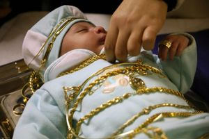 Pidyon Haben is a rite of passage in Judaism that is known as 'the redemption of the first born son'. It takes place when a baby is at least 31 days old, and involves 'buying him back from a Cohen.' Here the baby is draped in gold by the mother, grandmother and family and then bought back from a Cohen for 5 pieces of silver.