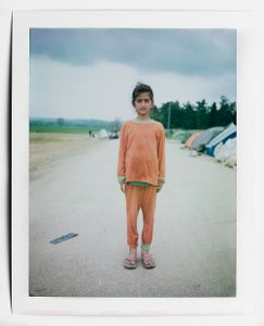 A young girl proudly posing for a portrait. Idomeni Camp, Idomeni, Greece, April, 2016.