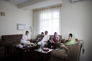 A family watching TV on a Friday afternoon | Kabul, Afghanistan 2012 © Sandra Calligaro