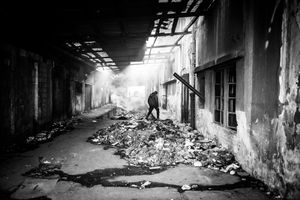 View of inside the abandoned barracks near the main train station in Belgrad. People live there in inhumane conditions.