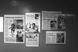 © Nafise Motlaq - Collection of newspapers about Lee's victories in Paralympic games at the wall of his massage center.