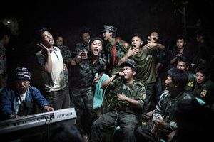 1st Prize Daily Life Single. Kachin Independence Army fighters are drinking and celebrating at a funeral of one of their commanders who died the day before. The city is under siege by the Burmese army © Julius Schrank, Germany, De Volkskrant