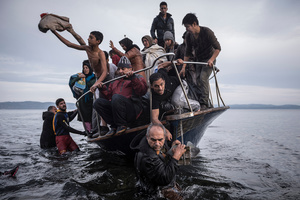 Refugees arrive by boat near the village of Skala on Lesbos, Greece, 16November 2015.