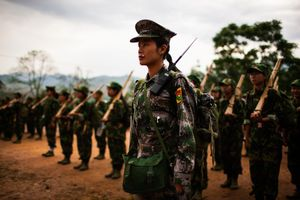 A member of the KIA's women's armed forces helps to lead basic military training at the army base outside of Laiza, Kachin State, Myanmar, May 13, 2013. Women in the army earn 10,000 Kyat per month (about 10 USD) and often once they have joined may only be discharged for the purpose of marriage. Men are expected to commit to the KIA for life. © Adriane Ohanesian
