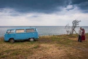 Turkey, TrabzonA couple stand next to a VW Camper van on a cliff overlooking the Black Sea.© Petrut Calinescu