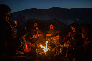 Tibetan Buddhist nomads cook by candlelight in Sertar county, Garze Tibetan Autonomous Prefecture, Sichuan province, China, 31 October 2015.