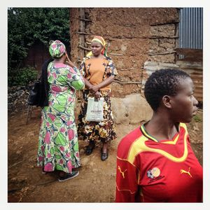 Women talk outside a house in Kibera. The Kibera slum is the largest slum in Nairobi with around half a million inhabitants.