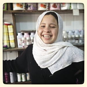 Portrait of Samar* in her parents small shop in Za'atari refugee camp in Jordan