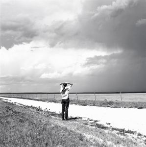 Enjoying the Wind. The Pawnee National Grasslands, Colorado. ca. 1973. © Robert Adams. Image courtesy of Fraenkel Gallery.