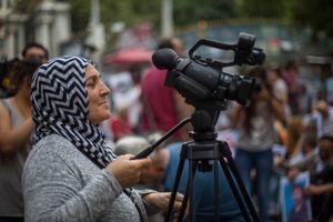 Hanim Tosun ,as a sentinel reporter for Ozgur Gundem Newspaper.