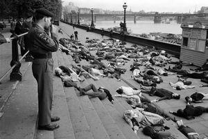 Ban the Bomb enactment showing casualties, Embankment, London, 1962 © Philip Jones Griffiths