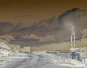 Smoke emission from the coal mining in Barentsburg. The Esmark glacier is pictured in the background.
