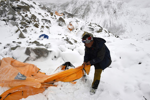 Trekking guide Pasang Sherpa searches for survivors among flattered tents moments after a wall of rock, snow and debris slammed on Everest Base camp.Nepal, 25 April 2015.