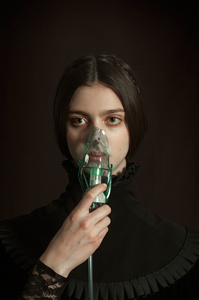 Portrait of girl with a nebulizer