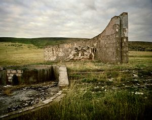 UNRECOGNIZED REPUBLIC OF NAGORNO-KARABAKH / Along the street to Mardakert/ 11.09.2011. Ruins of a War Memorial from the Soviet era in honor of the heroic war against Nazi Germany.