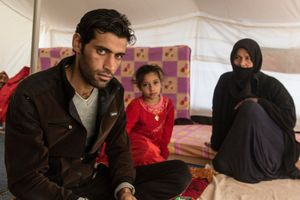 27/01/2015 -- Kirkuk, Iraq -- Ali Ahmad, Noor Zuher, and Layla Mahmud sit inside the tent. They lost 9 members of the family during the war mainly because of Iraqi air strikes, and Sheae militia's executions.