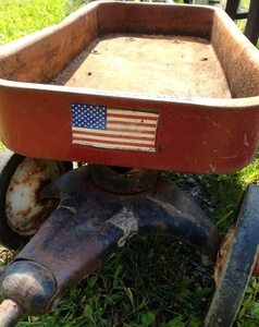wagon with flag - yard sale