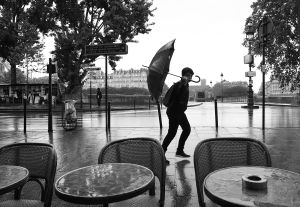 A Young Boy Walks on the Rain in Paris
