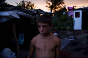 A young man in the Stara Gazela camp. © Matt Lutton