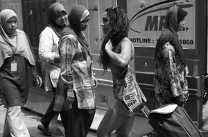 © Nafise Motlaq - Passing by some local women in Kuala Lumpur on her way back home from grocery.