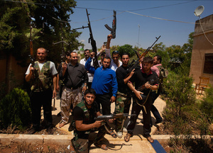 Recent recruits and voluneeters pose for a photo at an FSA center.