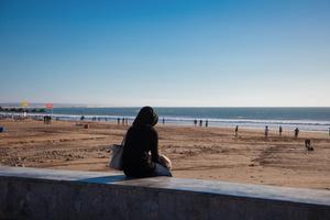 Agadir, March 2015. A girl alone sitting near the beach of Agadir.