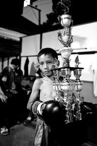 Boy with trophy after he has won the boxing match. © Sandra Hoyn