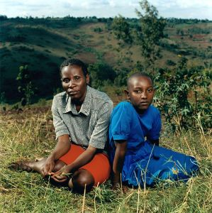 "Justin with her daughter Alice, Rwanda. ""We went to a church nearby because we thought that it would be safe. All of my family were killed in that church except me. About five thousand people had taken refuge there, but less than one hundred were rescued in the end."""