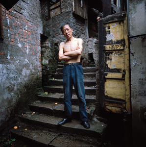 A masseur in the now destroyed old district of Chongqing