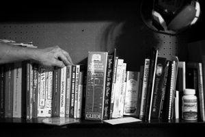 Dallas, Texas, 2010. A Texas Survivalist's library of survival books. © Spike Johnson