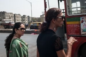Urmi and another hijra hail a cab to get to their next appointment.  © Alison McCauley