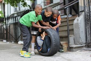 """We're going to get inside this tire and roll down the hill."" ""No, you're not."" ""Yes, we are!""""No, you're not."" From ""Humans of New York: Stories."" Published by St. Martin's Press."