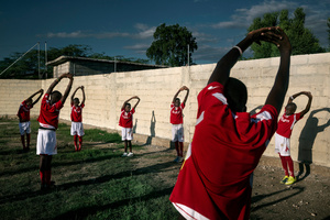 "Five years on from the earthquake, sports are one of the areas in which Haiti is beginning to recover. In every neighbourhood there are impromptu football and basketball matches to be seen. A football match at ""L'academia de futebol pero las negras."""