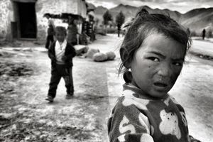 Taken in a small village along the Friendship Highway, on the way from Lhasa to Everest base camp. Around 4000 m above sea level.