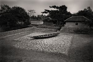A boat sits idle on a patch of land barren and cracked from salinity. Gabura, Satkhira. © Munem Wasif/VU'