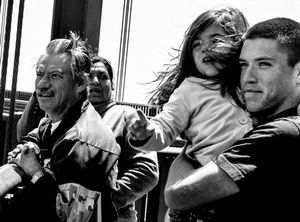 A family looks out at the San Francisco Bay from the Golden Gate Bridge.