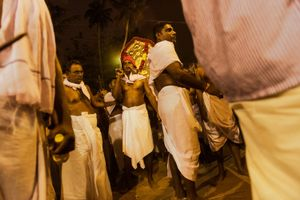 Priests of the Sridevi Bhagvaty temple leading a holy procession through the town. Kotakulangara, Kerala, India 2017