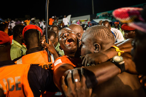 Lac de Geiers 2embraces his mentor and coach Lac de Guiers 1, who is overwhelmed by his feelings at the stadium Demba Diop after his successor´s sensational victory against wrestling legend Yekini on July 24 2016.