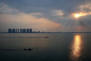 Sunset on the Fenghua river. This historical and culturally important river runs through Ningbo and its surrounding villages as a crucial water and supply source for the large local fishing economy. ©Souvid Datta