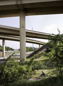 Juston Pope resting under an interstate on the site of the Nashville battlefield, 2010.