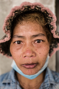 Portrait of Pich Sreyvy 32, from Svay Rieng Province after a days work.