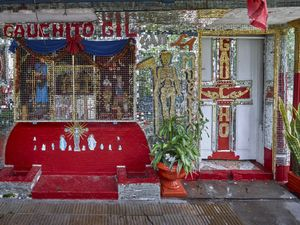 Eccentric decoration made of a mirrored tiles mosaic portraying the two popular saints Gauchito Gil and San la Muerte  of a private shrine in Resistencia in  Chaco