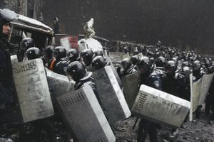Riot police returned to their former positions leaving the area near Lobonovskogo stadium after the crackdown of protesters in the center of Kiev on Jan. 22, 2014.
