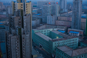 At dusk, the skyline of central Pyongyang, North Korea, 12 April 2011.