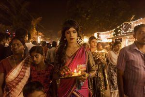 A male devotee dressed as a woman making his way to the Kotakulangara temple. Kotakulangara, Kerala, India 2017