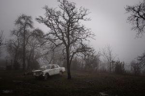 Rusty car in the yard. Ptsirtskha village, Abkhazia. © Olga Ingurazova