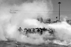 """Things intensified quickly. The protesters' tents were burned by police forces the following morning. The police then used tear gas in order to disperse the crown that had gathered. From the series """"Witnessing Gezi"""" © Emin Ozmen"""